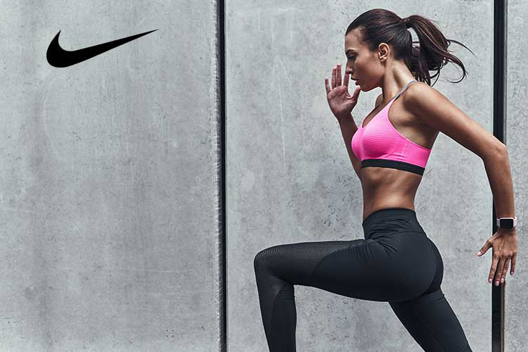 Nike Athletic Apparel Sale - Woman in pink top running